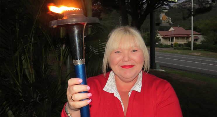 Darrelyn Perry with the Peace Torch in Bulahdelah.