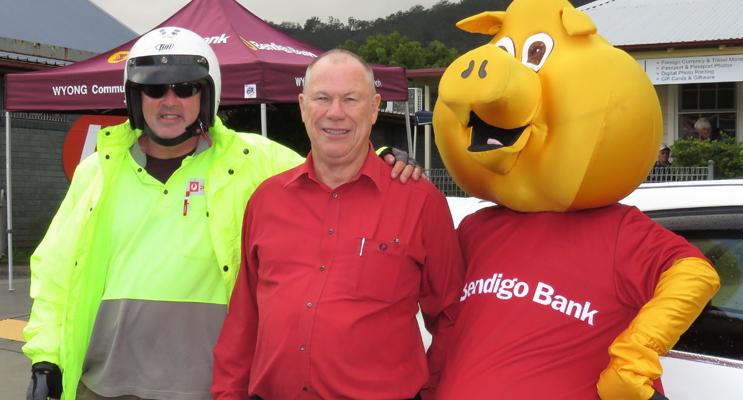 Postman Dave Burns, Roger Dixon and Piggy the Mascot.