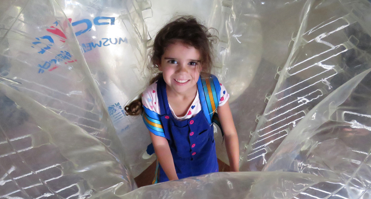 Five-year-old Abbiegail Ray said she loved rolling around in the giant bubbles.