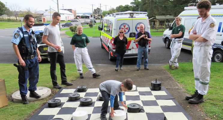 Andy Feeney enjoys a game of draughts on the giant board.