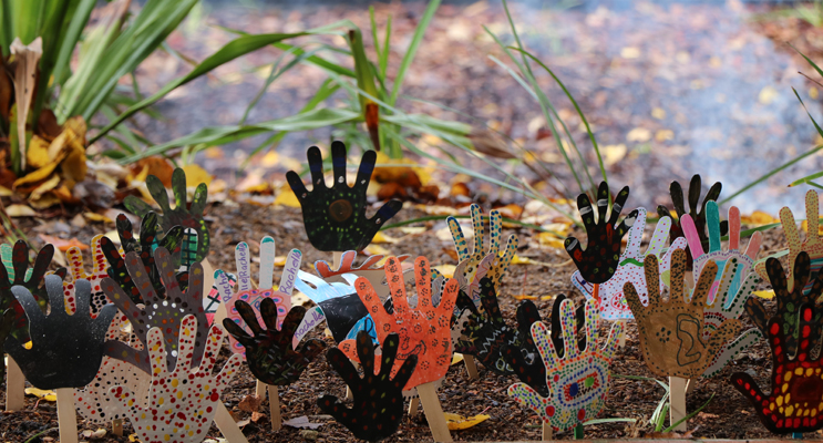 Hands painted in traditional painting styles adorned the Cultural garden for the official opening.