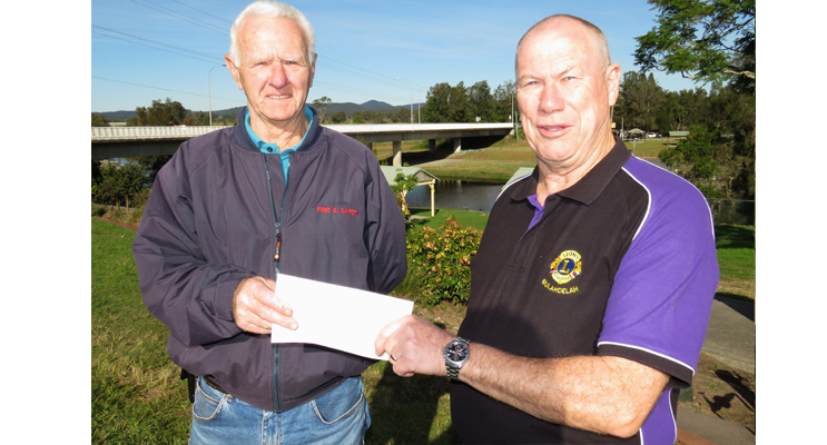 Roger Dixon accepts a donation on behalf of the Bulahdelah Activity Park Committee from Hunting Club Treasurer, Greg Russell.