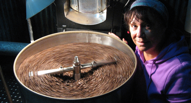 Jacqui with freshly roasted coffee beans at her Lemon Tree Passage headquarters.