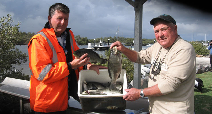 Craig and Max display their catch.