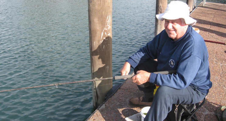 Ron Gunness fishing for blackfish inside the old Lemon Tree swimming pool.