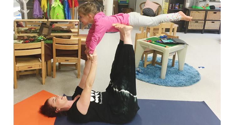 Ella completing an impressive superhero yoga move.