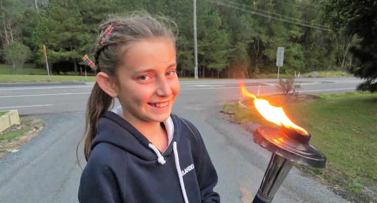 Inspired: Carol Poniris with the Peace Torch in Bulahdelah.