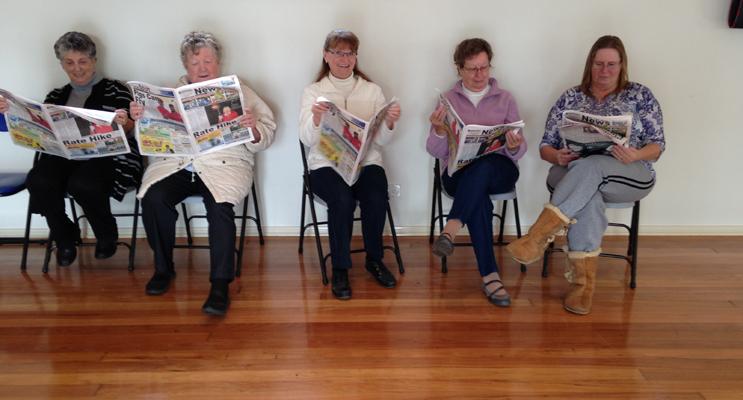 KEEPING UP WITH THE NEWS: Barbara Roworth, Lorraine Pevitt, Cheryl Flemming, Judy Staples, Glenys Robinson.