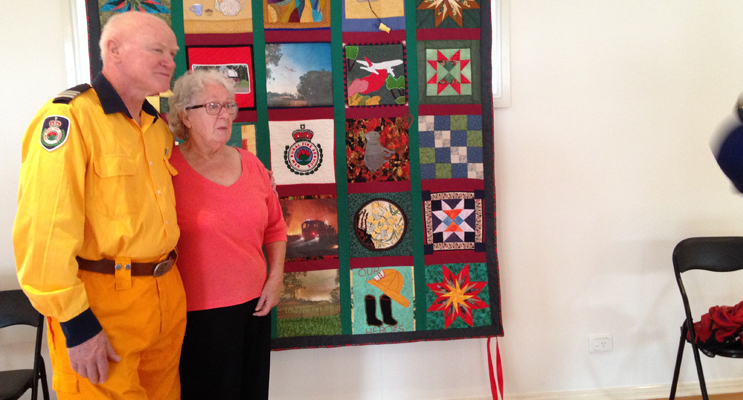 QUILT UNVEILED: Captain Ken Smee and Joyce Armstrong.