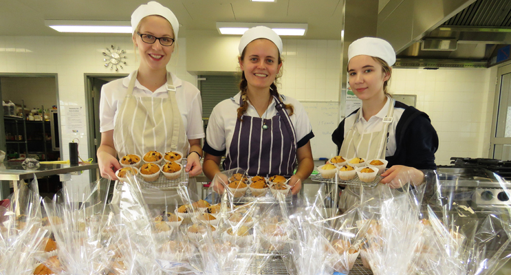 Act Of Kindness: Kaitlyn Gregory, Chelsea Reid and Katelyn Sibert prepare treats to deliver to the community.