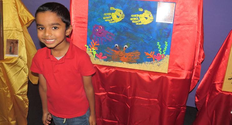 St Joseph's student, Akshay Sivaprasad, proudly displays his sea creature inspired artwork.