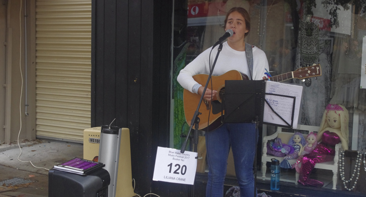 Blue Water Country Music Festival Busker Lili Crane on Stockton Street.