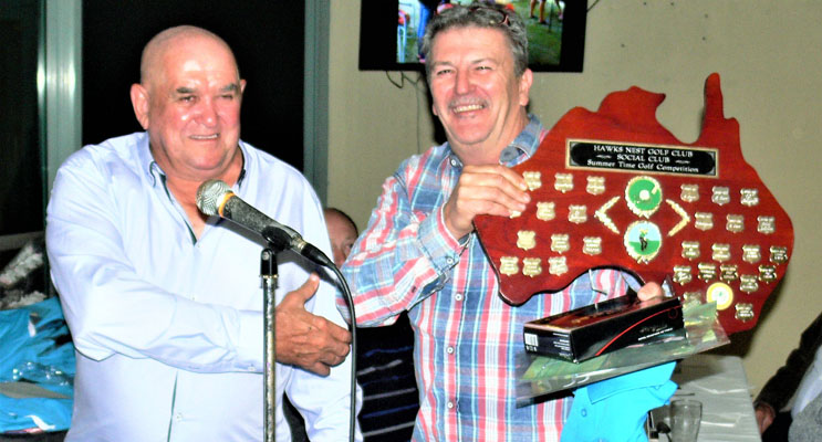 Social Club President Jim McDonald presenting Pat Henry the Twilight Golfing Champion trophy.