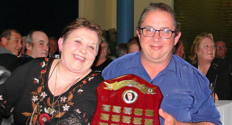 June West presenting Trevor Peirson the Darts champion trophy.