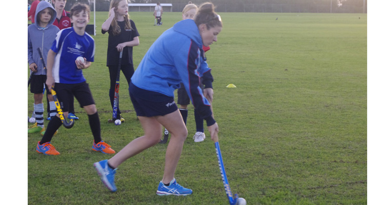 Kate Jenner out in front, with members of the Nelson Bay Hockey Club practising basic skills.