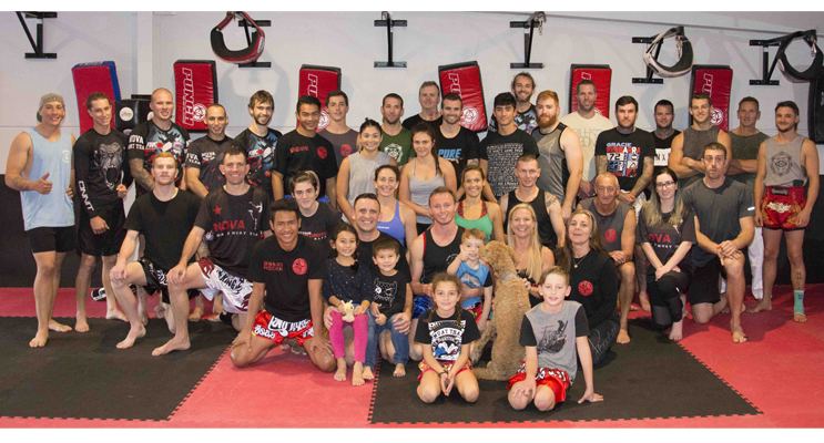 Group photo of attendees at the Muay Thai seminar held at PT Fitness, Taylors Beach.  Photo by Square Shoe Photography