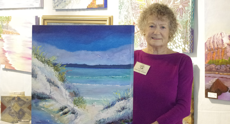 Margaret Watson with one of her works which she has donated to the Port Stephens Community Arts Centre as a raffle prize.  Photo by Marian Sampson.