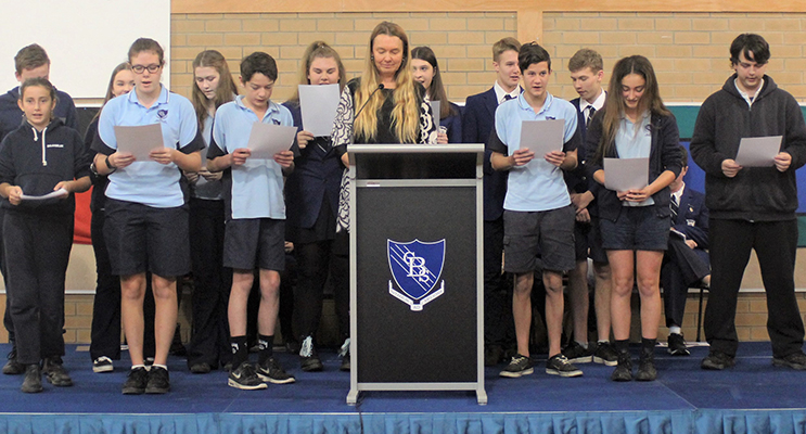The incoming SRC formally take their pledge of office with coordinating teacher, Ms Georgina Cunich.