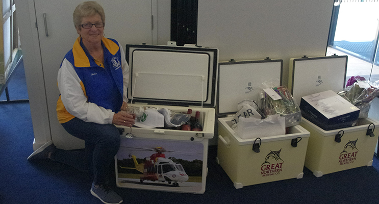 Helen Scott shows off the amazing prizes. Photo by Marian Sampson