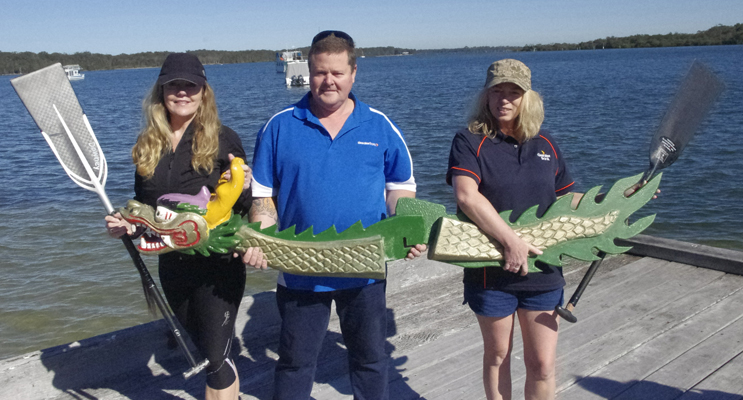 Deb and Andrew Downey, with Cherie Livingstone at Taylors Beach with the donated Dragon Boat Head and Tail. Photo by Marian Sampson.