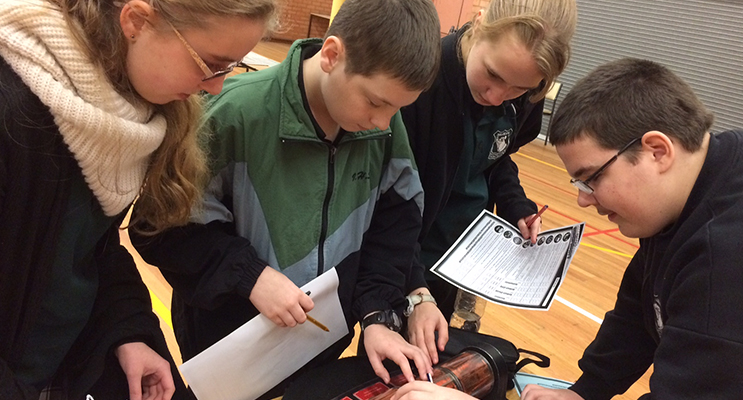Students analysing data at the forensics workshop.