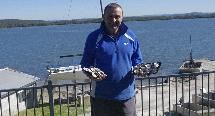 Fifth generation oyster grower Guy Holbert with some Port Stephens Oysters at Soldiers Point.  Photo by BayView Group