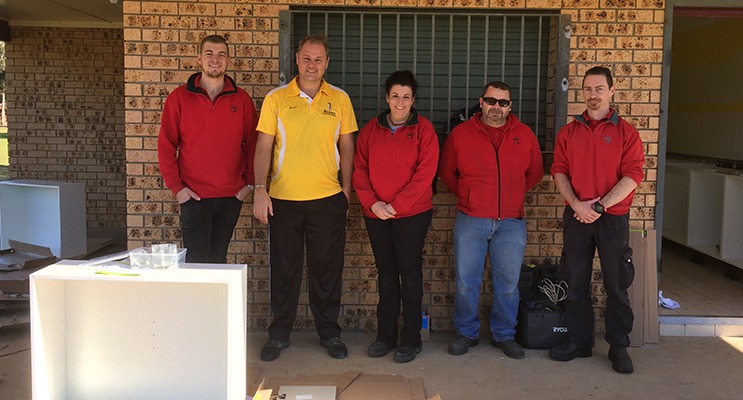 Little athletics volunteers and Bunnings staff installing the new kitchen: Jye Collinson, Jason Walls president, Margaret Webb, Drew Walker and Damian Meany.
