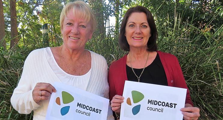 Jennifer Hughes and Julie Worth from Tea Gardens examine the new MidCoast logo.