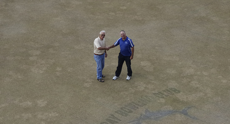 Nelson Bay Bowling Club Greenkeeper Rod Barker with Club Chairman Alan Barnes on the green at Nelson Bay Bowling Club.  Photo by Marian Sampson.