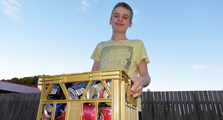Collecting aluminum cans provides some extra pocket money for Jack Cunich.