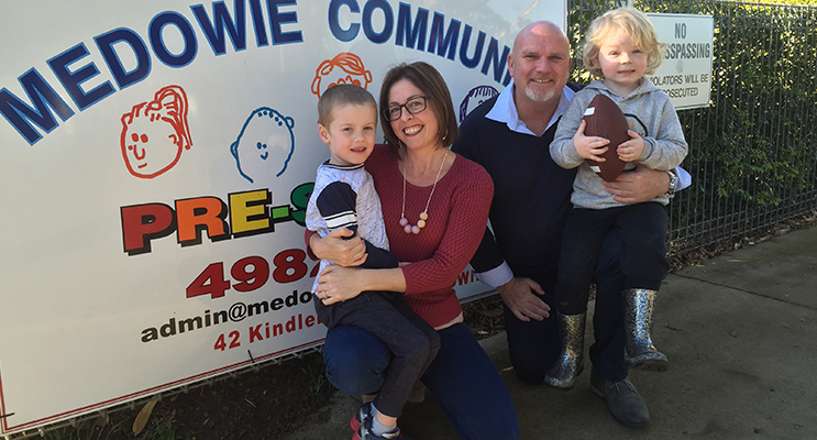 President Jacqui Hrast and Councillor and Deputy Mayor Chris Doohan outside Medowie Community Preschool with students Elliot and Xavier.
