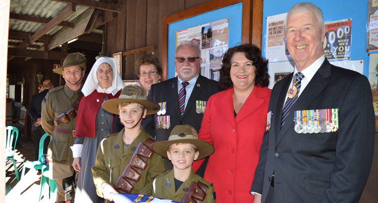 Jason and Renae Jenkins, Yvonne Fletcher, John Gillam, Meryl Swanson MP, and Air Vice Marshall Bob Treloar OAM (ret'd) with Michael (year 4) and Lachlan (year 2) holding the original medals.
