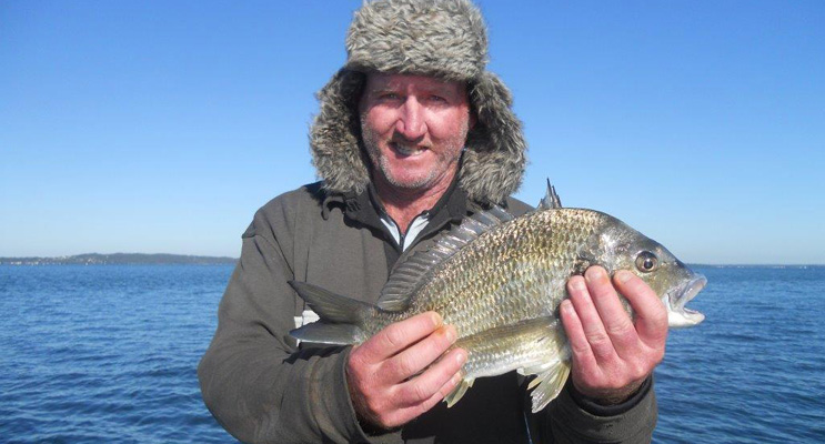 Seeing is believing – Dave Hoyle with his 40cm bream and Ron Gunness with his catch.