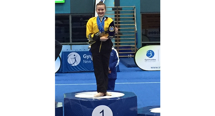 Emily on the first place podium at her recent competition.