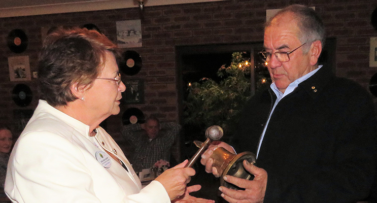 Gong and Gavel: District chairperson Inga Kasch and new President Arthur Baker.