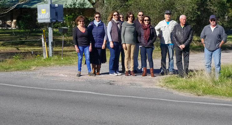 Members of the  South Tomaree Community Association on Gan Gan Road where school students need to cross from one side to the other to ride safely.  Photo by Marian Sampson