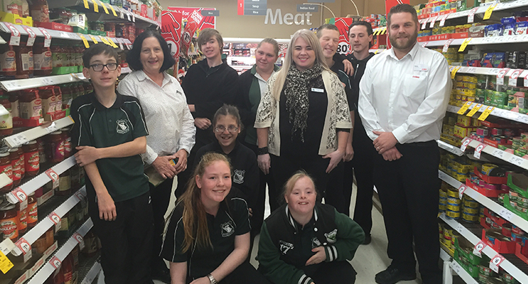 Students and staff from the Learning Support program with relieving Store Manager James Day.