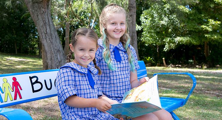 Learning Together: Tea Gardens Kindergarten student Cydee Adams with Arabella Sylvaney from Year 5. Photo: TGPS