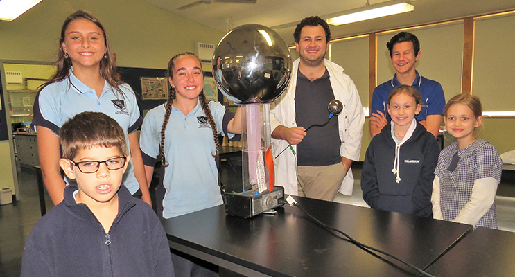 Learning Together: BCS Year 9 students Lilly Brown, Tahlia Mancini and Hunter Bramble share their scientific skills with Charlie Matheson, Mia Hope and Salome Reitsma, with Mr Tim Cooper.
