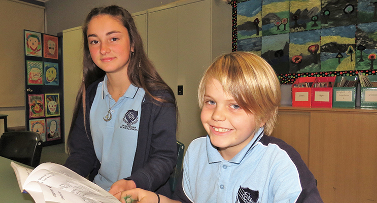 Learning Together: Year 9 student Katerina Poniris reading with Henry O'Connell.