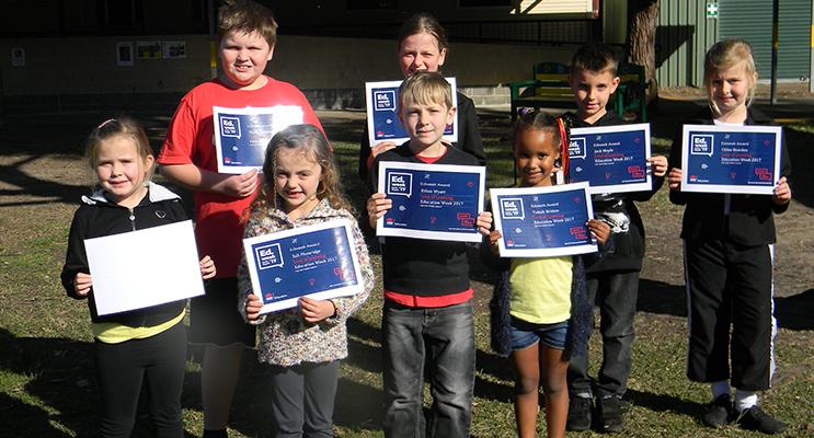 Salt Ash students proudly displaying their awards.