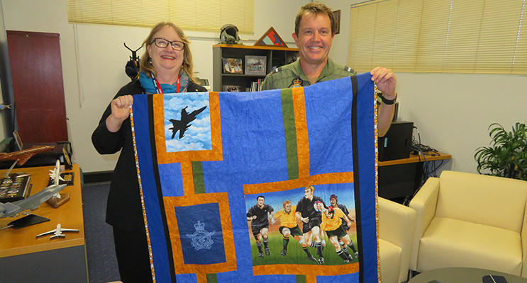 Mrs Jan-Maree Ball presents an Aussie Hero Quilt to Air Commodore Michael Kitcher.