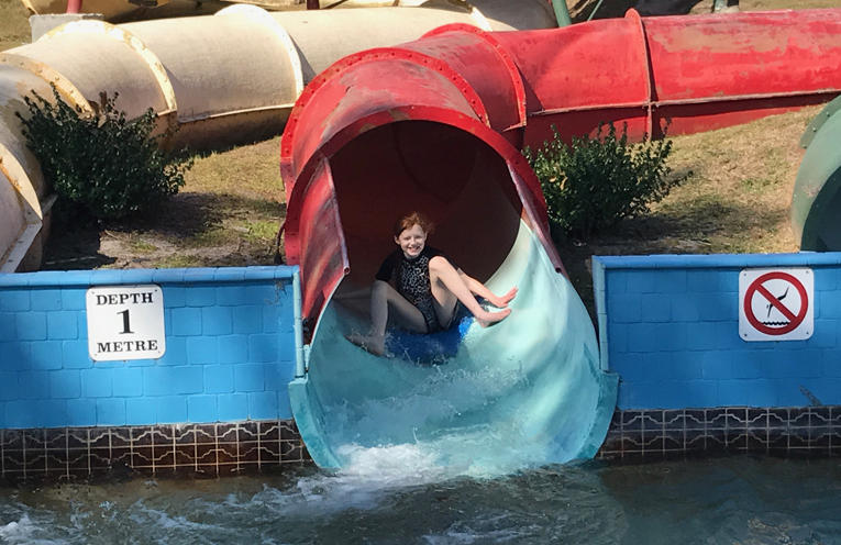 KARUAH PRIMARY ADVENTURE: Jessica on the water slide.