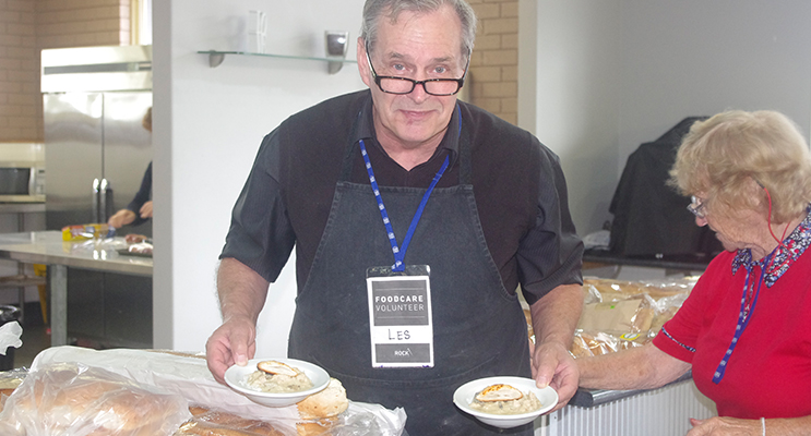 Retired Chef Les White serving up hot meals to all who come through in winter.  Photo by Marian Sampson