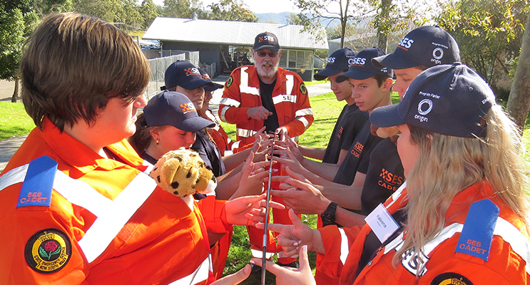 Teamwork: Regional Coordinator Garry Fajks leads the cadets in a challenge.