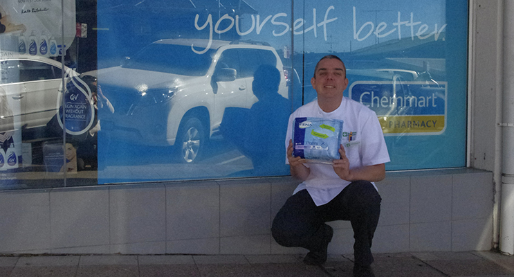 Scott Elsegood supporting share the dignity sanitary items drive. Terry White Chemmart is one collection point in Nelson Bay.  Photo by Marian Sampson