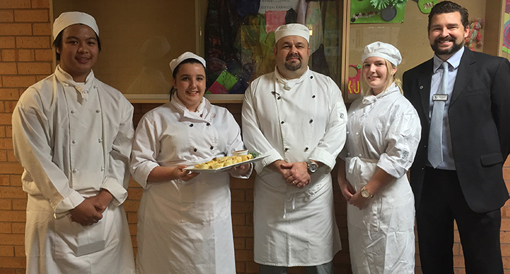 Irrawang High students catered to the VIP guests with handmade delicious creations: Grant Bernardo, Ashley Pearson, teacher Chris Enright, Chloe Lambert and principal Paul Baxter.