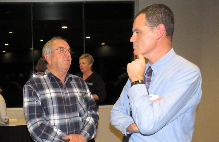 Arthur Baker discusses local projects with Malcolm St Hill from the Department of Industries.