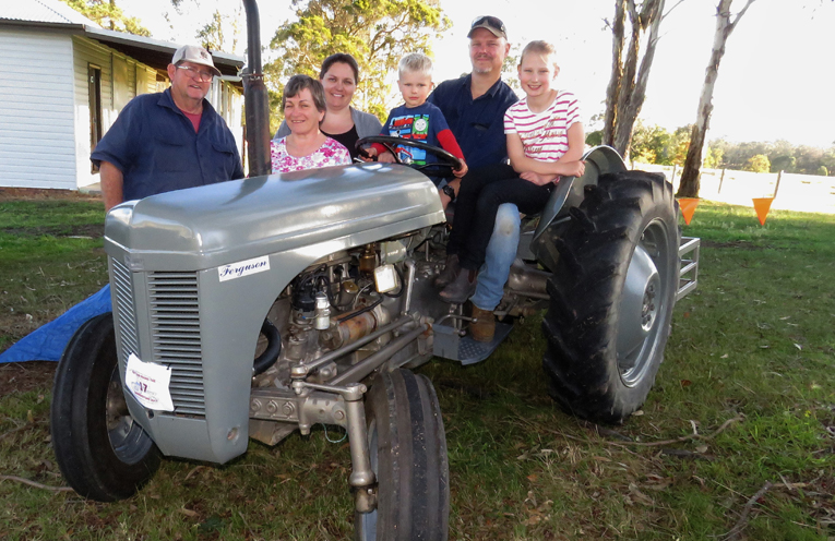 Merv and Sarah Turner with Emily, Darcy, Ben and Charlee Morgan and their 1948 TE20 Ferguson Tractor.
