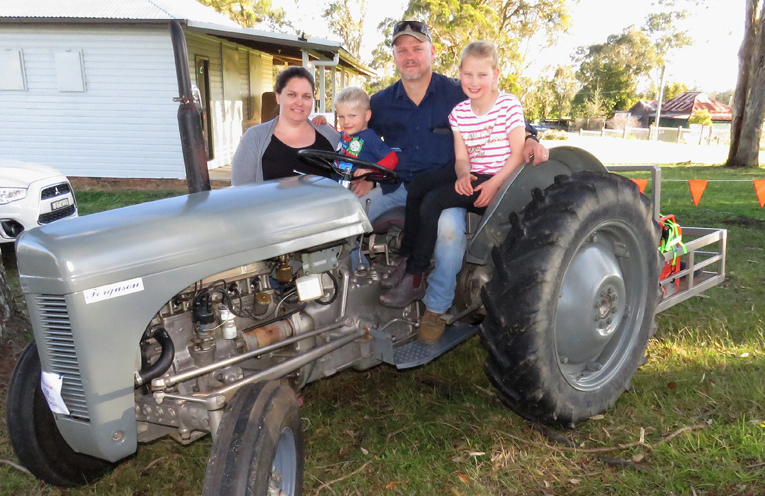 Emily, Darcy, Ben and Charlee Morgan with their 1948 TE20 Ferguson Tractor, named Charlee.